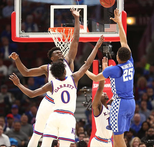 14a17f430ba Several Jayhawks defend against a shot from Kentucky forward PJ Washington  (25) during the