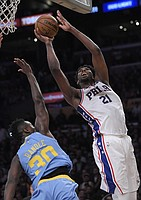 Philadelphia 76ers center Joel Embiid, right, shoots as Los Angeles Lakers forward Julius Randle defends during the second half of an NBA basketball game, Wednesday, Nov. 15, 2017, in Los Angeles. The 76ers won 115-109. (AP Photo/Mark J. Terrill)