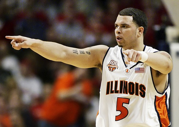 Illinois' Deron Williams directs his teammates in the second half against Wisconsin during the championship game of the Big Ten tournament Sunday, March 13, 2005, at the United Center in Chicago. (AP Photo/Michael Conroy)