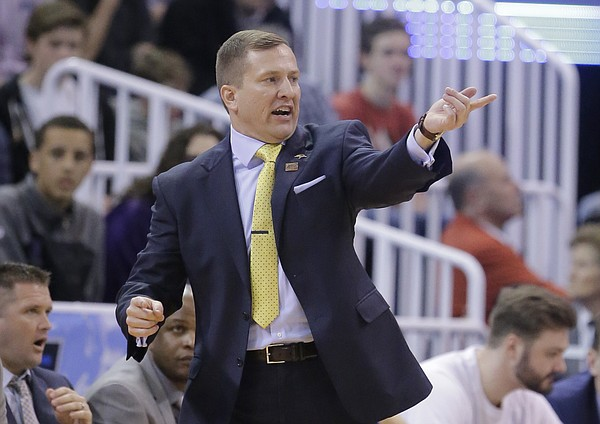 South Dakota State head coach T.J. Otzelberger shouts to his team during the first half of a first-round men's college basketball game in the NCAA Tournament against Gonzaga Thursday, March 16, 2017, in Salt Lake City.