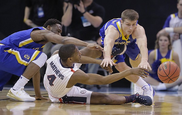 Gonzaga guard Jordan Mathews (4) passes the ball as South Dakota State's Tevin King, left, and Lane Severyn, right, defend during the first half of a first-round men's college basketball game in the NCAA Tournament, Thursday, March 16, 2017, in Salt Lake City.