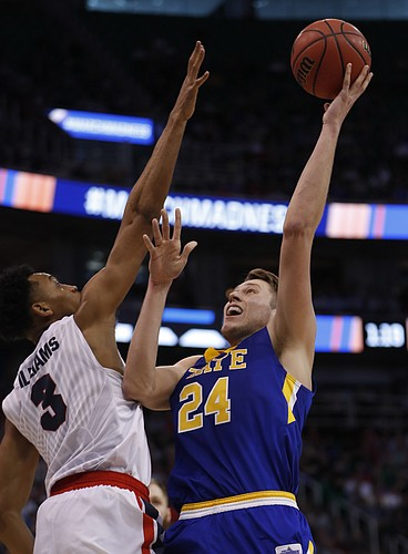South Dakota State forward Mike Daum (24) shoots over Gonzaga forward Johnathan Williams (3) during the second half of a first-round men's college basketball in the NCAA Tournament Thursday, March 16, 2017, in Salt Lake City. Gonzaga defeated South Dakota State 66-46.