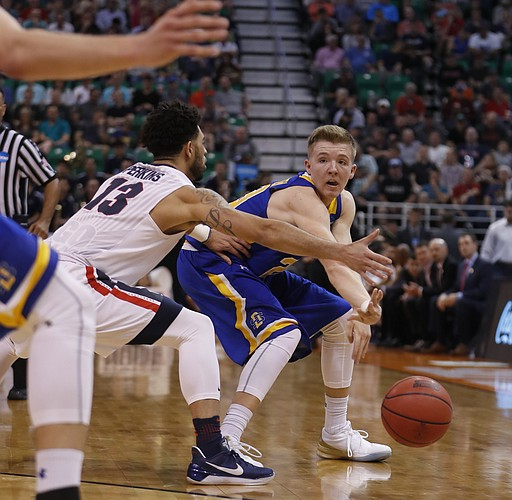 South Dakota State guard Reed Tellinghuisen (23) pass the ball past Gonzaga guard Josh Perkins (13) during the second half of a first-round men's college basketball in the NCAA Tournament Thursday, March 16, 2017, in Salt Lake City. Gonzaga defeated South Dakota State 66-46.