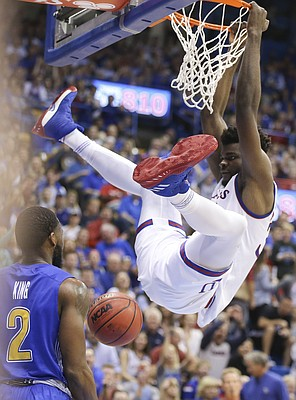 Kansas center Udoka Azubuike (35) delivers a dunk before South Dakota State guard Tevin King (2) during the first half on Friday, Nov. 17, 2017 at Allen Fieldhouse.