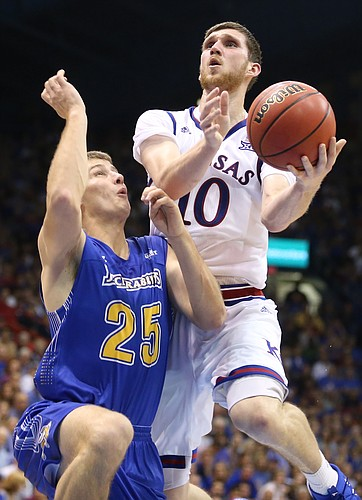 Kansas guard Sviatoslav Mykhailiuk (10) goes to the bucket against South Dakota State guard Lane Severyn (25) during the second half on Friday, Nov. 17, 2017 at Allen Fieldhouse.