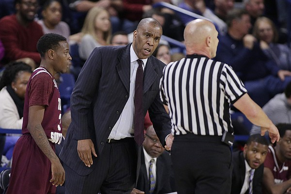 Texas Southern head coach Mike Davis, center, speaks with a referee during the second half of an NCAA college basketball game against Gonzaga in Spokane, Wash., Friday, Nov. 10, 2017.
