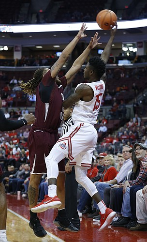 Ohio State's Kam Williams, right, saves the ball from going out of bounds as Texas Southern's Kevin Scott defends during the second half of an NCAA college basketball game Thursday, Nov. 16, 2017, in Columbus, Ohio.
