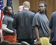 Ramone Singleton, right, turns to look at the gallery at the end of a preliminary hearing on Tuesday, Nov. 21, 2017, in Douglas County District Court. Singleton is one of three men charged with murder and other crimes in connection with a Sept. 2, 2017 shooting at the North Lawrence Motel 6. Also pictured, at left, is co-defendant Tyrone J. Carvin with his appointed defense attorney, Michael Clarke, center.