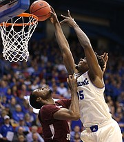 Kansas center Udoka Azubuike (35) powers in a dunk over Texas Southern center Trayvon Reed (5) during the first half, Tuesday, Nov. 21, 2017 at Allen Fieldhouse.