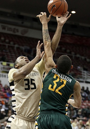 Oakland's Martez Walker (35) has his shot tipped away by Wright State's Joe Thomasson (32) during the second half of a NCAA college basketball game in the Horizon League tournament Monday, March 7, 2016, in Detroit.