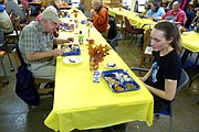 Dale Cannon, of Topeka, (left) and Samantha Pettyjohn, of Lawrence, enjoy LINK Thanksgiving meals Thursday in the basement of the First Christian Church, 1000 Kentucky St. The two said they were grateful for the food and company on the holiday.