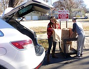 Olivia Kennedy, 15, of Frankfort, and Cody Andrews, 14, of Tonganoxie, load LINK Thanksgiving meals for home delivery Thursday at Maceli's in downtown Lawrence. Kennedy was visiting her Lawrence family, who has made a Thanksgiving tradition of delivering the LINK meals. Andrews was a volunteer at Maceli's were 600 meals were prepared for home delivery this year.