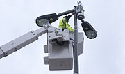 In this file photo from March 23, 2016, a city employee installs a temporary surveillance camera near Ninth and Massachusetts streets. Temporary cameras are sometimes installed to oversee areas where large crowds are expected, such as Final Four celebrations downtown, though those cameras are removed after events.