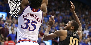 Kansas center Udoka Azubuike (35) gets up for a lob dunk against Oakland forward Isaiah Brock (10) during the first half on Friday, Nov. 24, 2017 at Allen Fieldhouse.
