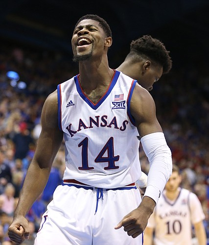 Kansas guard Malik Newman (14) roars after an and-one bucket during the second half on Friday, Nov. 24, 2017 at Allen Fieldhouse.
