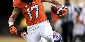 Kansas corner back DeAnte Ford (27) falls short trying to stop a touchdown by Oklahoma State wide receiver Dillon Stoner (17) during an NCAA college football game between Kansas and Oklahoma St in Stillwater, Okla., Saturday, Nov. 25, 2017.