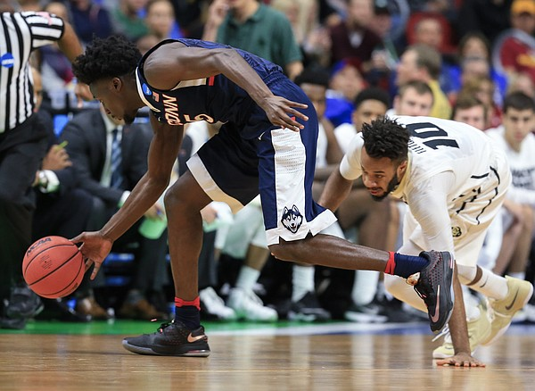 Connecticut's Daniel Hamilton (5) steals the ball from Colorado's Tre'Shaun Fletcher (10) during a first-round men's college basketball game in the NCAA Tournament in Des Moines, Iowa, Thursday, March 17, 2016. Connecticut won 74-67.