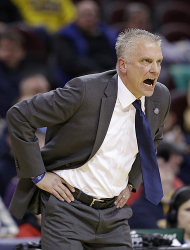 Toledo head coach Tod Kowalczyk yells to players during the first half of an NCAA college basketball game in the third round of the Mid-American Conference tournament Thursday, March 12, 2015, in Cleveland. Toledo defeated Eastern Michigan 78-67.