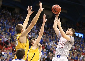 Kansas guard Sviatoslav Mykhailiuk (10) puts up a shot over Toledo forward Luke Knapke (30) and Toledo forward Nate Navigato (35) during the first half on Tuesday, Nov. 28, 2017 at Allen Fieldhouse.
