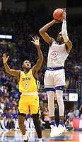 Kansas guard Lagerald Vick (2) puts up a three against Toledo guard Marreon Jackson (3) during the first half on Tuesday, Nov. 28, 2017 at Allen Fieldhouse.