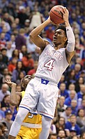 Kansas guard Devonte' Graham (4) pulls up for a shot over Toledo guard Marreon Jackson (3) during the first half on Tuesday, Nov. 28, 2017 at Allen Fieldhouse.
