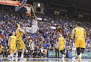 Kansas center Udoka Azubuike (35) delivers a dunk before Toledo forward Luke Knapke (30) during the first half on Tuesday, Nov. 28, 2017 at Allen Fieldhouse.