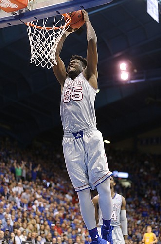Kansas center Udoka Azubuike (35) soars in for a dunk during the second half on Tuesday, Nov. 28, 2017 at Allen Fieldhouse.