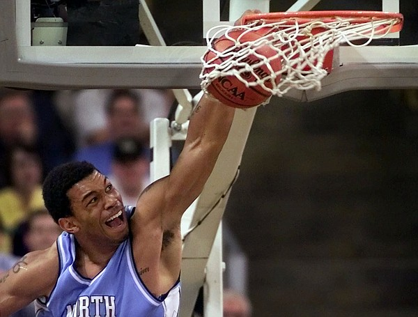 FILE — North Carolina's Julius Peppers dunks in the fourth quarter of their 80-74 win over Wake Forest at the Joel Coliseum in Winston-Salem, N.C., Tuesday Feb. 6, 2001. (AP Photo/Chuck Burton)