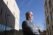 Bob Augelli, a lecturer in the School of Business and program director for the multicultural business scholars program. Augelli is pictured outside Capitol Federal Hall on the KU campus on Thursday, Nov. 30, 2017.