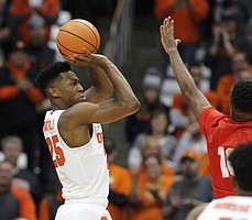 Syracuse's Tyus Battle, left, shoots over Cornell's Matt Morgan, right, in the first half of an NCAA college basketball game in Syracuse, N.Y., Friday, Nov. 10, 2017.