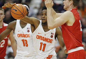 Syracuse's Oshae Brissett battles for a loose ball in the second half of an NCAA college basketball game against Cornell in Syracuse, N.Y., Friday, Nov. 10, 2017.