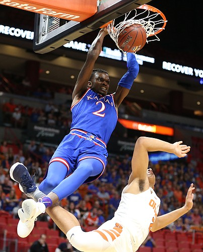 Kansas guard Lagerald Vick (2) delivers on a lob dunk over Syracuse forward Matthew Moyer (2) during the first half, Saturday, Dec. 2, 2017 at American Airlines Arena in Miami.