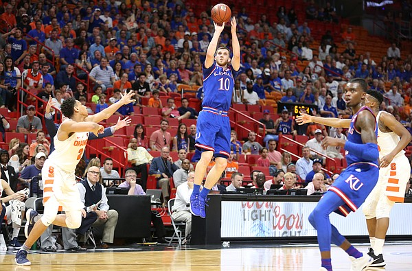 Kansas guard Sviatoslav Mykhailiuk (10) spots up for a three before Syracuse forward Matthew Moyer (2) during the first half, Saturday, Dec. 2, 2017 at American Airlines Arena in Miami.