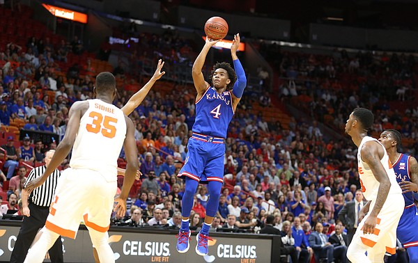 Kansas guard Devonte' Graham (4) pulls up for a three during the first half, Saturday, Dec. 2, 2017 at American Airlines Arena in Miami.