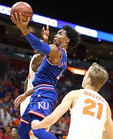 Kansas guard Devonte' Graham (4) swoops in for a shot during the second half, Saturday, Dec. 2, 2017 at American Airlines Arena in Miami.