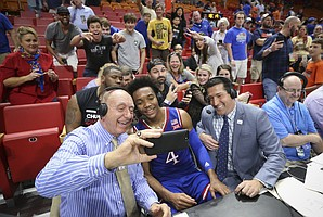 Kansas guard Devonte' Graham (4) leans in for a selfie with ESPN broadcaster Dick Vitale following his 35-point performance in the Jayhawks' 76-60 win over Syracuse, Saturday, Dec. 2, 2017 at American Airlines Arena in Miami.