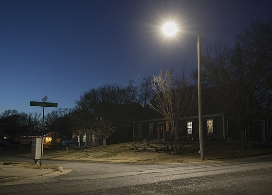 An LED streetlight with a color temperature of 4,000 kelvins and no shields installed is pictured at dusk on Nov. 30, 2017, in the 1600 block of Lindenwood Lane.