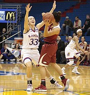 Kansas junior guard Kylee Kopatich closely guards Arkansas sophomore Jailyn Mason in the closing seconds of the Jayhawks' 71-60 win over the Razorbacks on Sunday during the Big 12/SEC Challenge at Allen Fieldhouse.