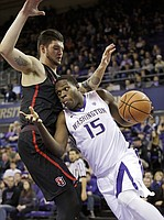 Washington's Noah Dickerson (15) tries to drive past Seattle's Aaron Menzies in the second half of an NCAA college basketball game Friday, Nov. 24, 2017, in Seattle. Washington won 89-84.