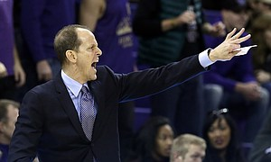 Washington head coach Mike Hopkins directs his team against Seattle in an NCAA college basketball game against Seattle Friday, Nov. 24, 2017, in Seattle.