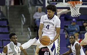 Washington's Matisse Thybulle comes down with the ball against Seattle in the first half of an NCAA college basketball game Friday, Nov. 24, 2017, in Seattle.