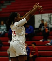 Lawrence High senior Asia Goodwin (24) shoots a basket during the game against Hayden on Dec. 5, 2017. Lawrence won 61-49.