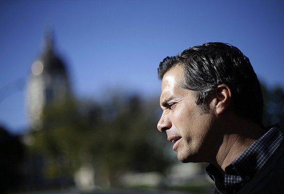 In this file photo from Nov. 1, 2014, independent senate candidate Greg Orman talks to reporters during a campaign event in Topeka, Kan. (AP Photo/Charlie Riedel)