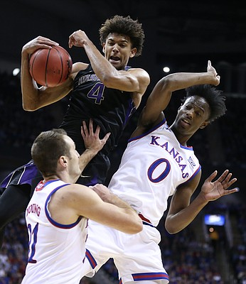 Washington guard Matisse Thybulle (4) grabs a rebound over Kansas guard Clay Young (21) and Kansas guard Marcus Garrett (0) during the first half, Wednesday, Dec. 6, 2017 at Sprint Center.