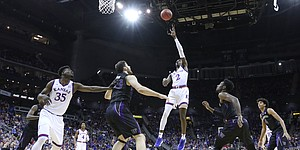 Kansas guard Lagerald Vick (2) puts up a shot in the paint during the first half, Wednesday, Dec. 6, 2017 at Sprint Center.