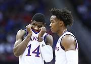 Kansas guard Malik Newman (14) and Kansas guard Devonte' Graham, have a talk during the second half, Wednesday, Dec. 6, 2017 at Sprint Center.