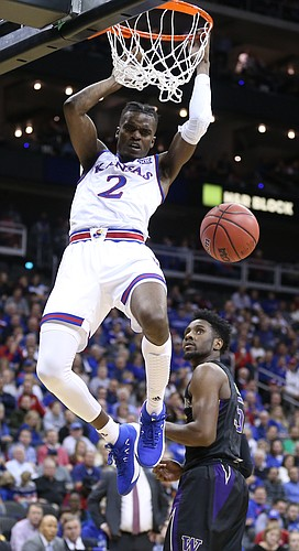 Kansas guard Lagerald Vick (2) comes down off the rim after a dunk during the second half, Wednesday, Dec. 6, 2017 at Sprint Center.