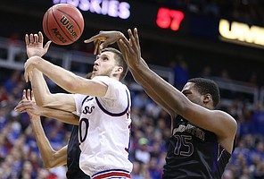 Kansas guard Sviatoslav Mykhailiuk (10) has the ball knocked away by Washington forward Noah Dickerson (15) during the second half, Wednesday, Dec. 6, 2017 at Sprint Center.