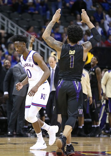 Washington guard David Crisp (1) raises up his arms after hitting a late three pointer against Kansas guard Marcus Garrett (0) during the second half, Wednesday, Dec. 6, 2017 at Sprint Center.