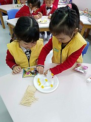 Two students at Shanghai's Copernic Kindergarten school construct houses out of toothpicks and candy during a lesson last month. Three Lawrence educators travelled to China just before Thanksgiving to share STEM teaching strategies with teachers at Copernic as part of the U.S.-China Kindergarten 